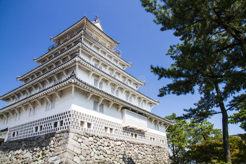 Ancient Japanese castle and trees royalty free stock image