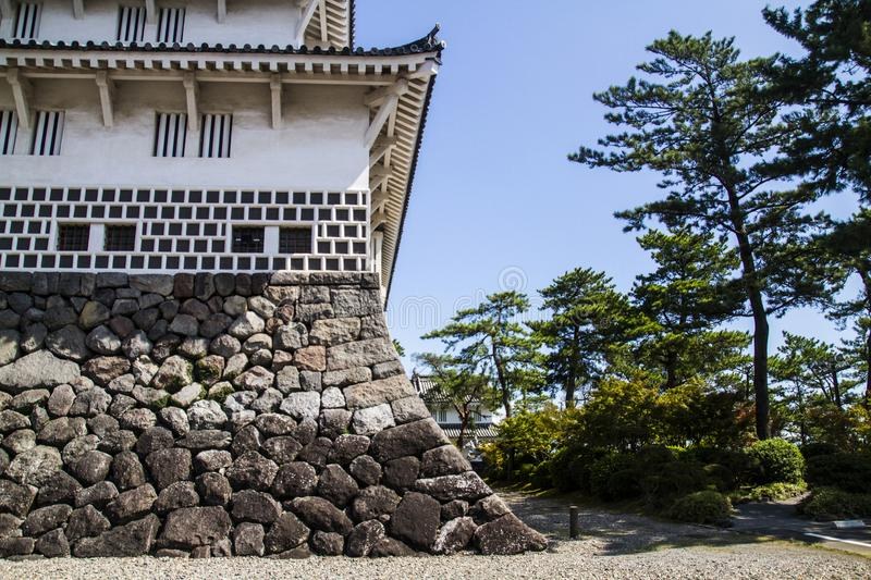Ancient Japanese castle and trees stock images