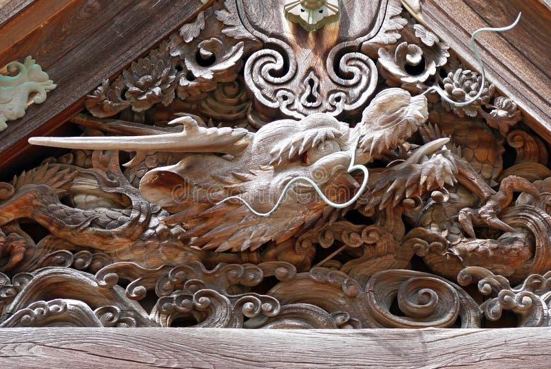 Ancient Japanese Wood Carving Sacred Dragon Head at Mount Koya. Ancient Japanese Wood Carving of Sacred Dragon Head inside Old Temple at Mount Koya royalty free stock photo
