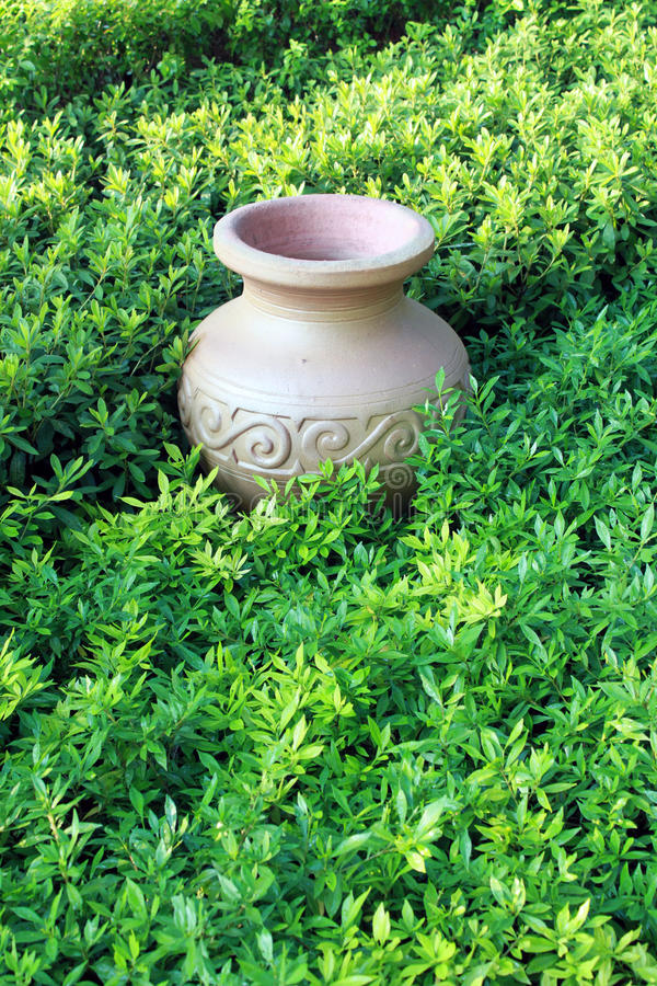 ancient jar in grassland royalty free stock image