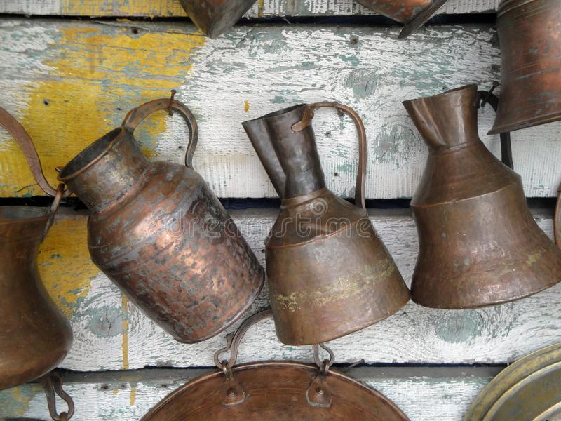 Ancient jugs. Copper jugs at the flea market in Tbilisi Georgia royalty free stock images