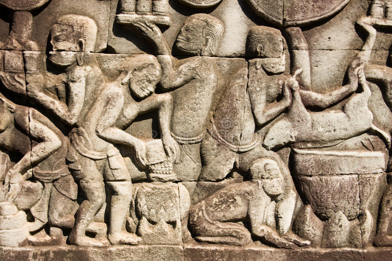 Ancient Khmer cooking scene. Ancient bas relief carving showing Khmer people cooking. Frieze at Bayon Temple, Angkor Thom, Siem Reap, Cambodia stock image