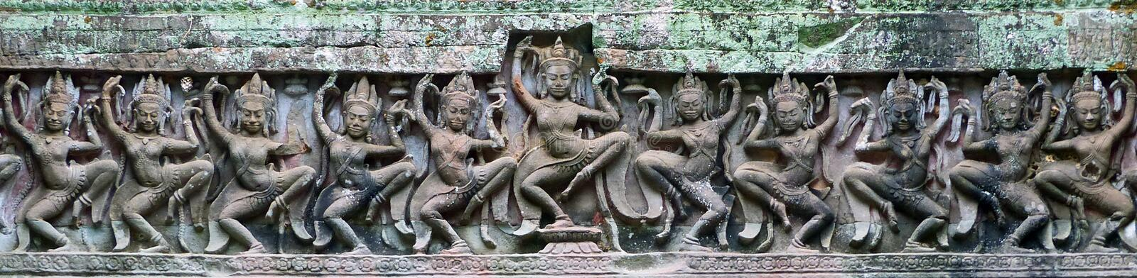 Ancient Khmer Laterite Stone Carving of Female Dancers stock images