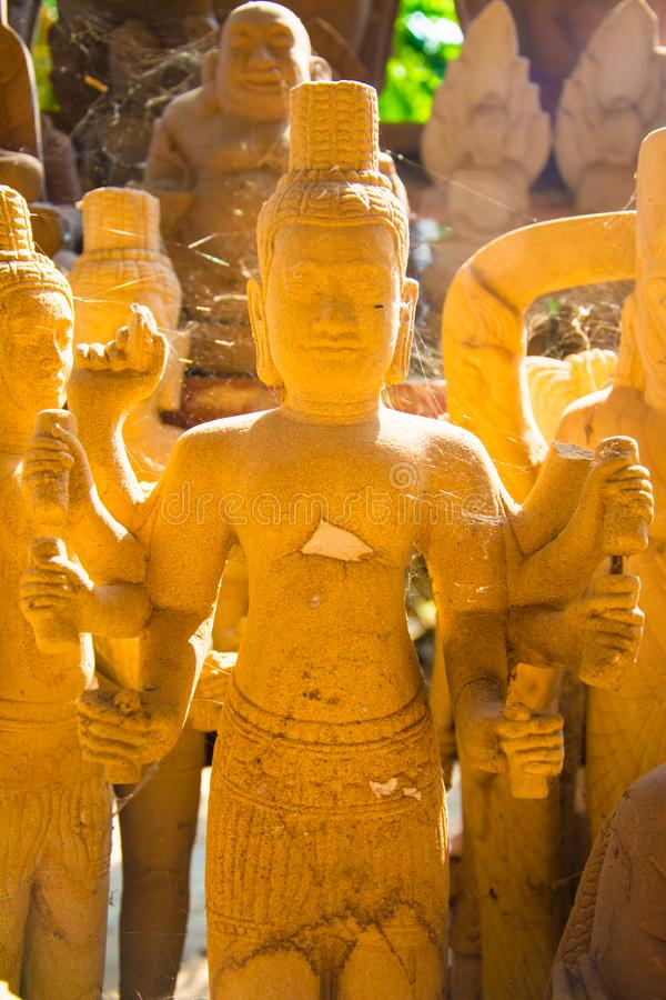 Ancient Khmer statues carved from stone. Ancient Khmer statues carved from stone which this statue is a Khmer art with soft light affect the statue stock image