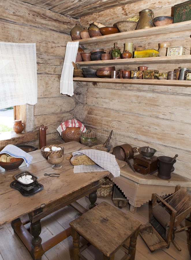 Ancient kitchen in a wooden log hut, Russia.  stock photos