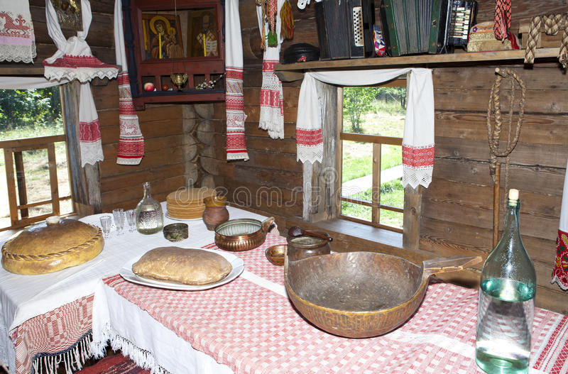 Ancient kitchen in a wooden log hut, Russia . Ancient kitchen in a wooden log hut, Russia stock photos