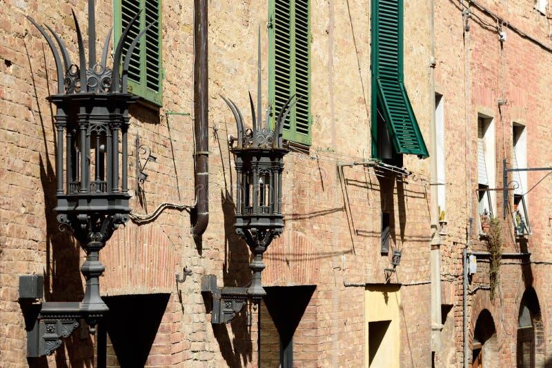 Ancient Lamps, Siena, Tuscany, Italy stock image