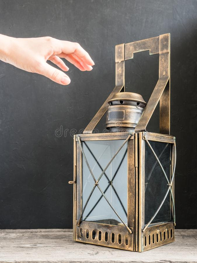 Ancient lantern. Old vintage metal railway lamp on black background. Artistic still life royalty free stock photo