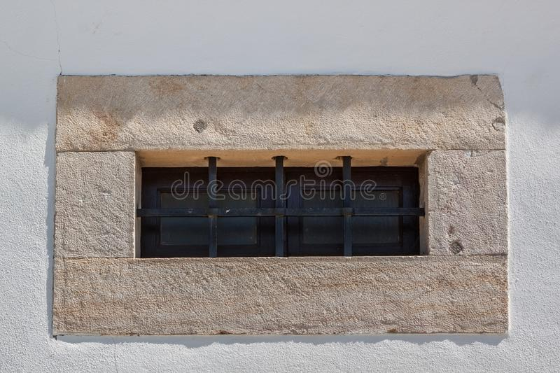 An ancient lattice of a prison window. thick wall. stock images