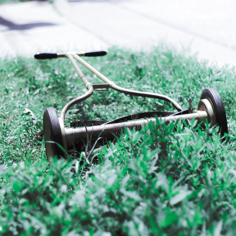 An old fashion push lawn mower. An ancient lawn mower for landscape royalty free stock photography