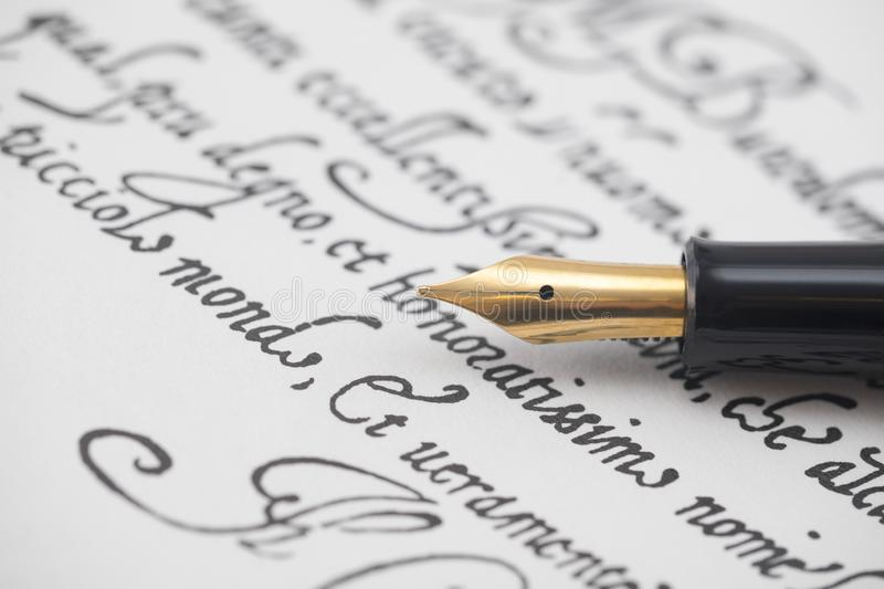 Ancient letter from 16th century with elegant fountain pen. Ancient letter in latin from 16th century with elegant fountain pen stock photo