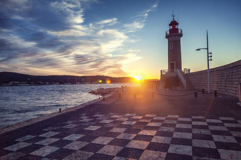 Ancient lighthouse at sunset in Saint-Tropez, a trip to the French Riviera Provence in France royalty free stock images