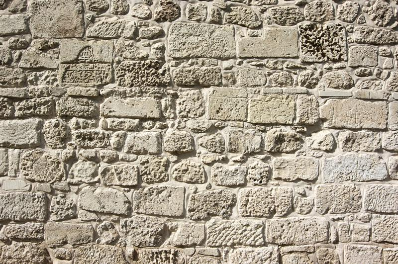 Ancient limestone walling texture. As background stock photo