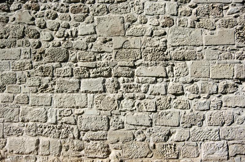 Ancient limestone walling texture. As background royalty free stock image