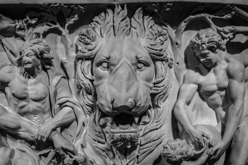 Ancient lion head relief on the wall. Mythology stone art bas-relief. Uvarov sarcophagus dating from 210 AD royalty free stock photos