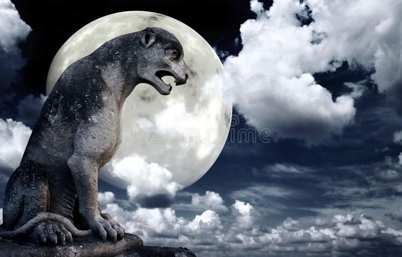 Ancient lion statue and bright moon in the night sky. Elements of this image furnished by NASA stock images