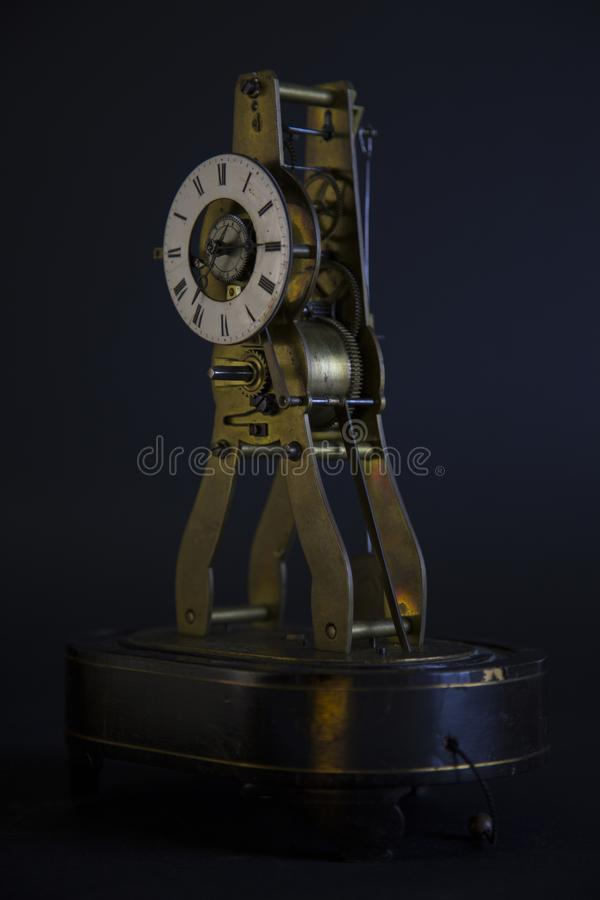 Ancient lusty watch mechanism. On a black background with hours royalty free stock photo
