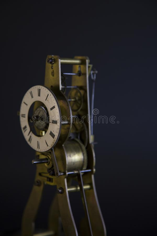 Ancient lusty watch mechanism. On a black background with hours stock image
