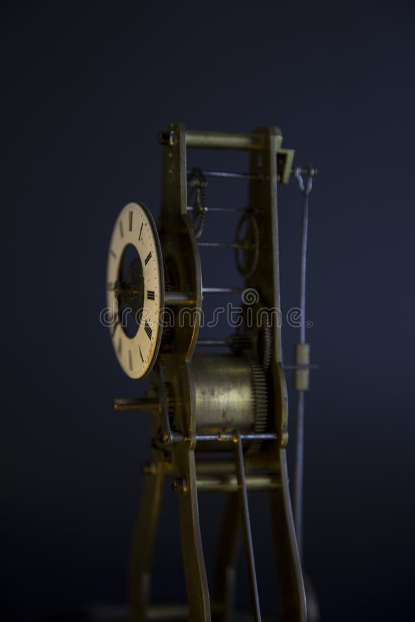 Ancient lusty watch mechanism. On a black background with hours royalty free stock photos