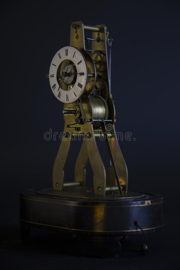 Ancient lusty watch mechanism. On a black background with hours stock photography