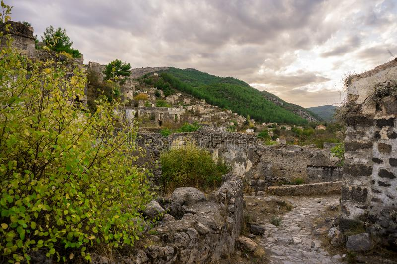 Ancient Lycian village and houses of Kayakoy, Fethiye, Mugla, Turkey. Ghost Town Kayaköy, anciently known as Lebessos royalty free stock image