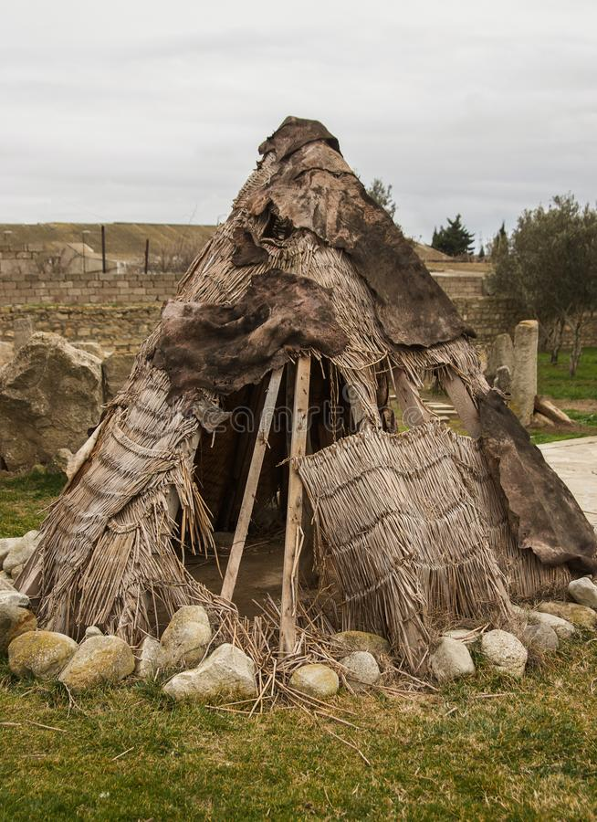 Ancient man hut. Teepee or wigwam tent house, outdoors royalty free stock photos