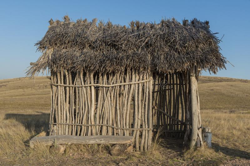 Ancient man. straw roof hut, bungalow. Construction for housing stock photography