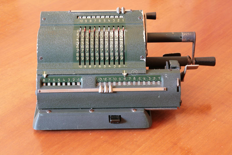 Ancient manual calculator stock image