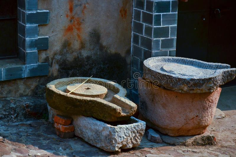 Ancient manual millstone  ,  mortar for making rice stock photos