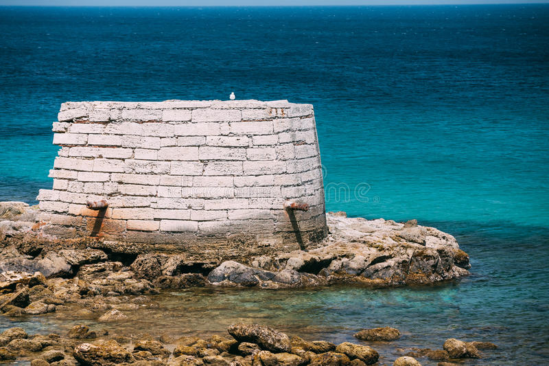 Ancient marine fortifications. Ruins of old tower into Mediterra. Nean Sea in Tarifa, Spain. Tarifa is the most southern town of Europe on the Strait of royalty free stock photos