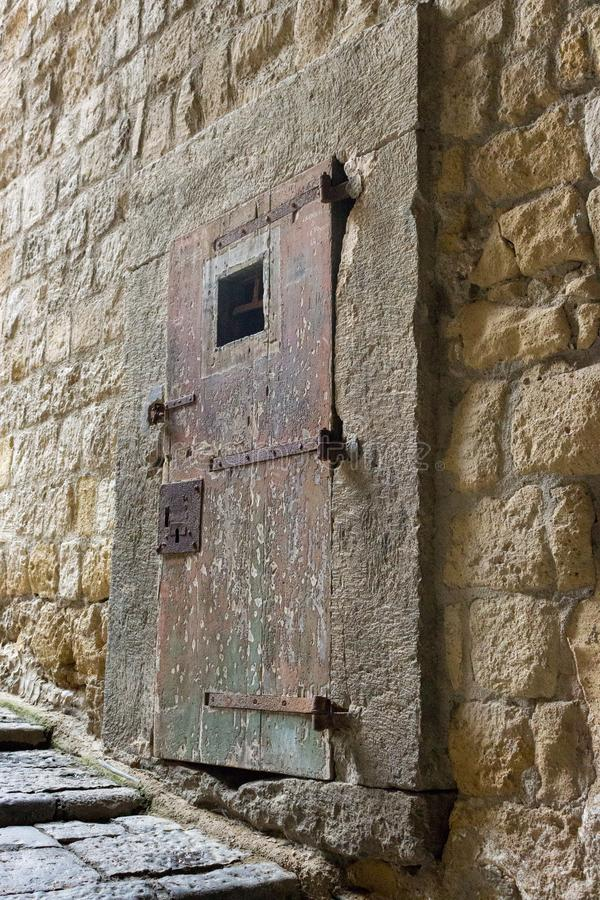 Ancient massive wooden door in medieval fortress. Old entrance in european castle in Italy. Italian architecture royalty free stock photos