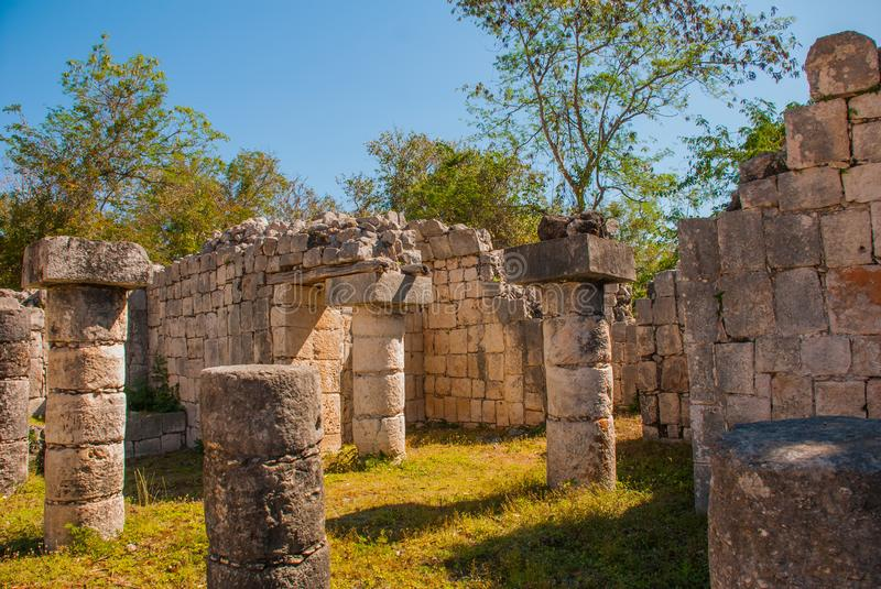 Ancient Mayan city.Ancient Mayan city. Destroyed buildings and columns of the forest. Chichen-Itza, Mexico. Yucatan. Ancient Mayan city. Ancient Mayan city stock photo