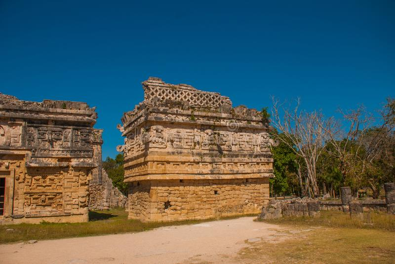 Ancient Mayan city. Destroyed buildings and pyramids in the forest. Chichen-Itza, Mexico. Yucatan.  stock image