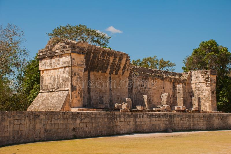 Ancient Mayan city. Ruined buildings and pyramids. Chichen-Itza, Mexico. Yucatan. Ancient Mayan city. Ruined buildings and pyramids on the background of blue sky stock image