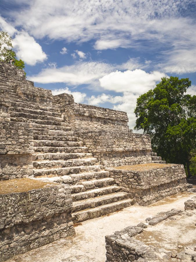 Ancient Mayan stone structure at Calakmul, Mexico. With clouds in the background royalty free stock photos