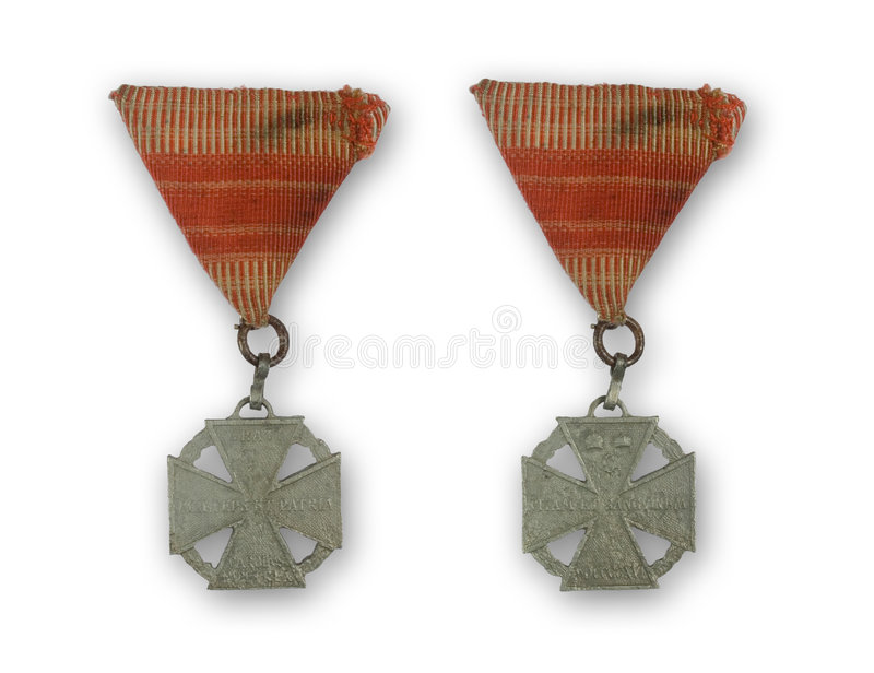 Ancient medal. With red ribbon from 1916 royalty free stock photo