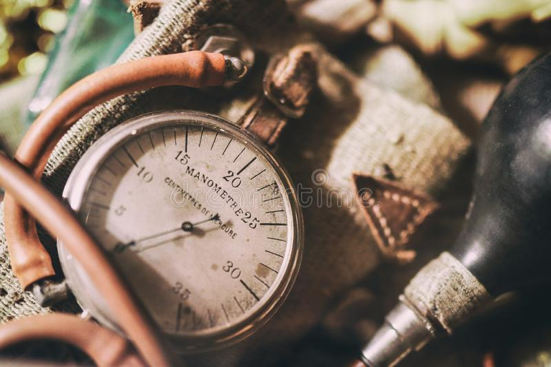 Ancient medical equipment: close-up retro manometer,  blowing pear. Vintage background from a collection of antiques. Close-up. Selected focus stock image