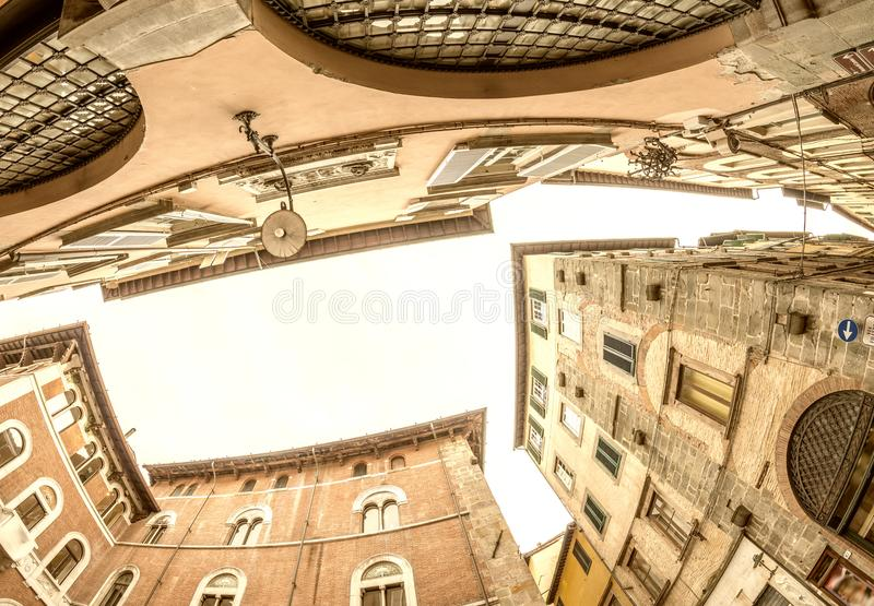 Ancient medieval city buildings of Lucca, Tuscany. Fisheye view stock photography