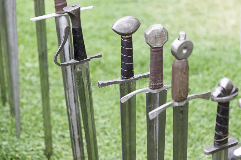 Ancient medieval swords. Detail of a weapon of war and death, art and history royalty free stock photography