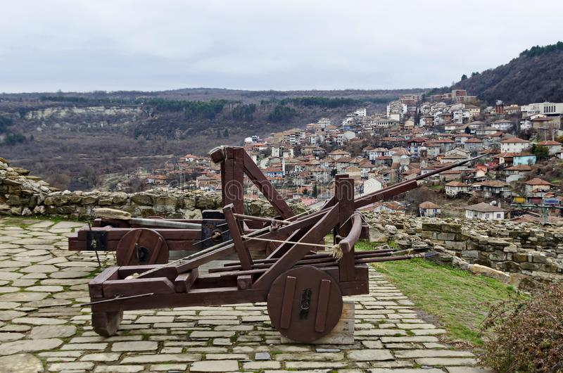Ancient medieval wooden Crossbow and Catapult in Tsarevets fortress on a background residential neighborhood, Veliko Tarnovo stock photo