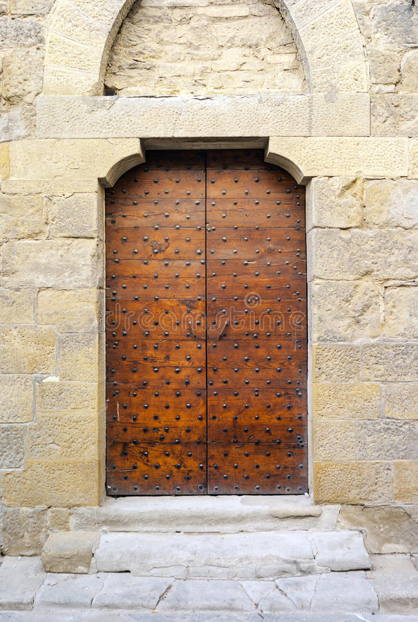 Ancient medieval wooden door. Color image royalty free stock photo