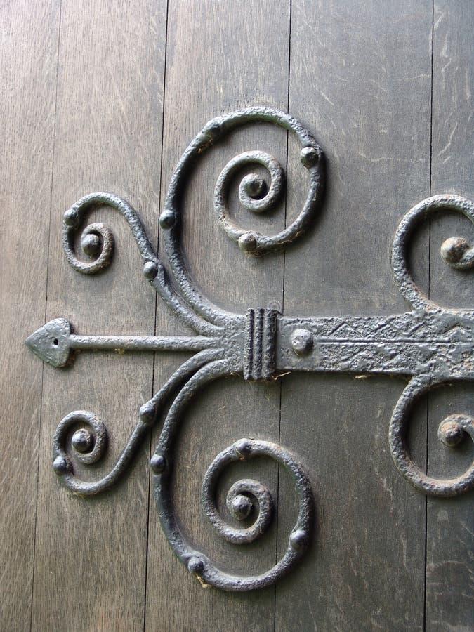 Ancient metal door hinge royalty free stock image