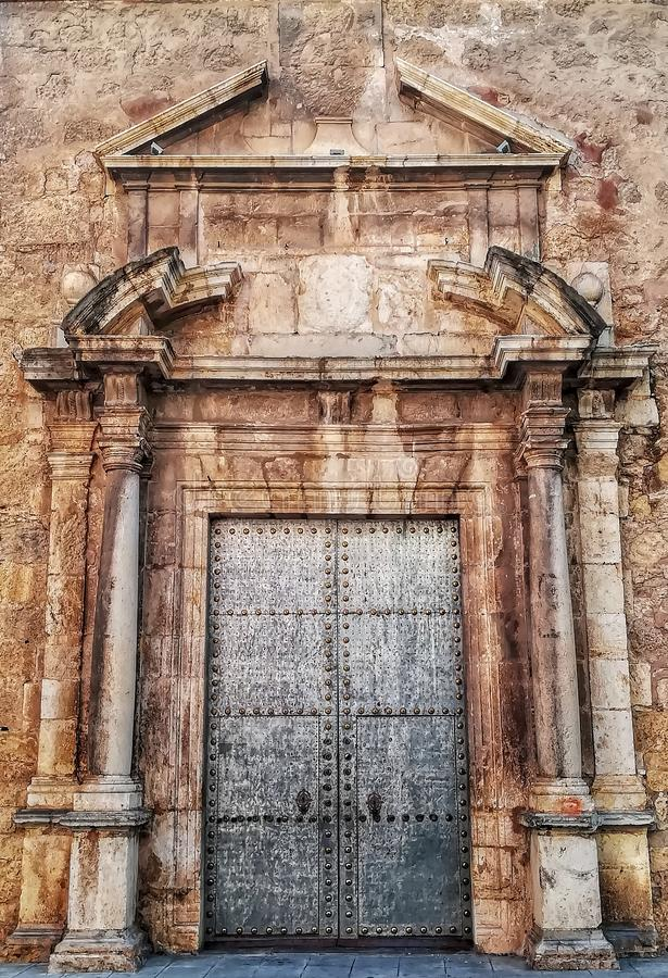 Ancient metal door with stone ornamentation royalty free stock photos