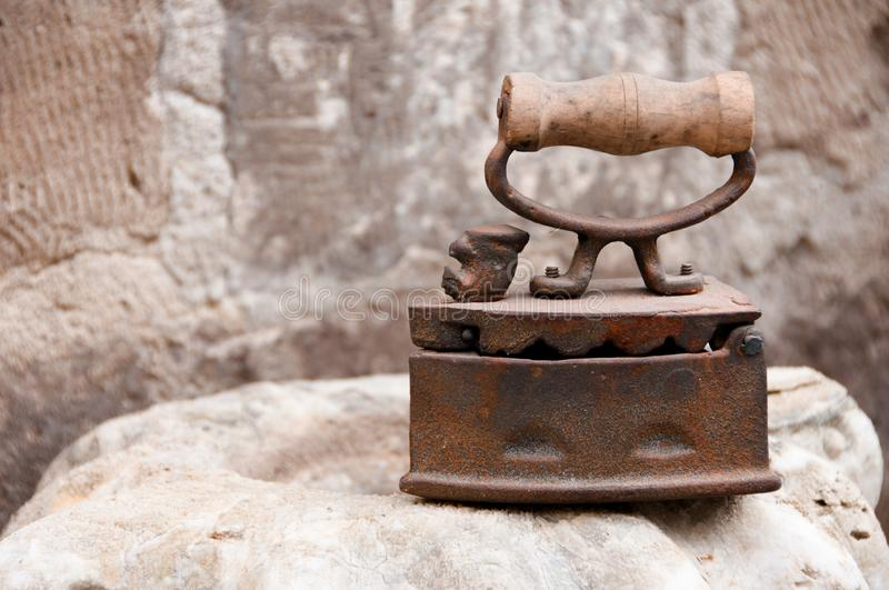 Ancient metal iron with wooden handle royalty free stock photos