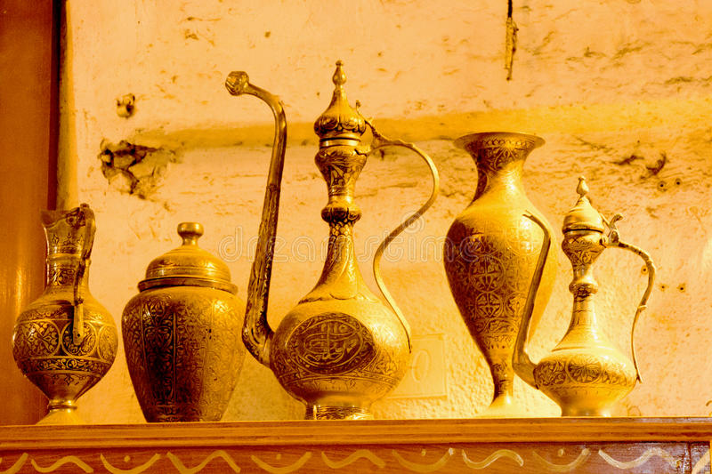 Ancient metal jug in oriental style. In antique market stock images