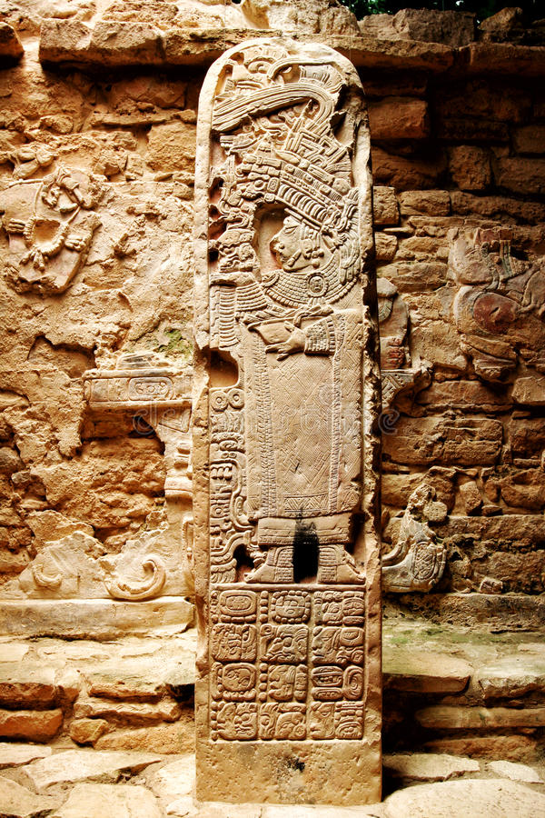 Ancient Mexican column stone totem with carvings of the Maya. Ancient Mexican stone column totem with carvings of the Maya. Location: Chichen itza stock photography