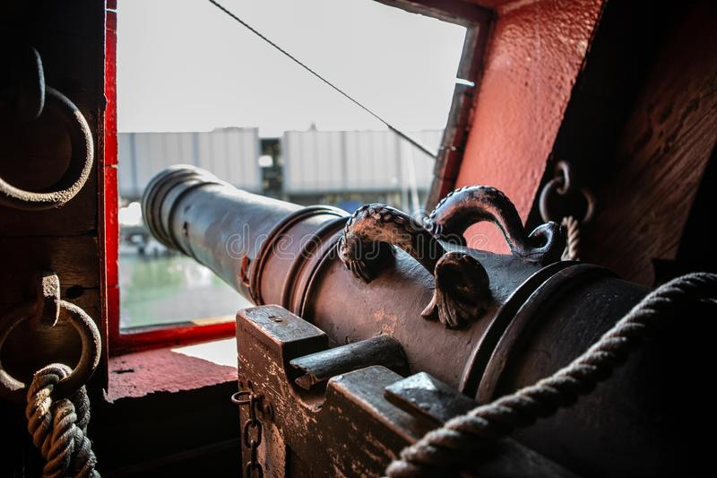 Old pirate galleon cannons inside hold space royalty free stock image
