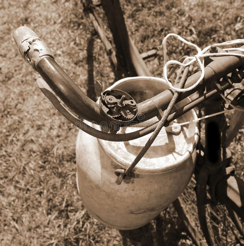 ancient milking bicycle with the old aluminum milk can royalty free stock images