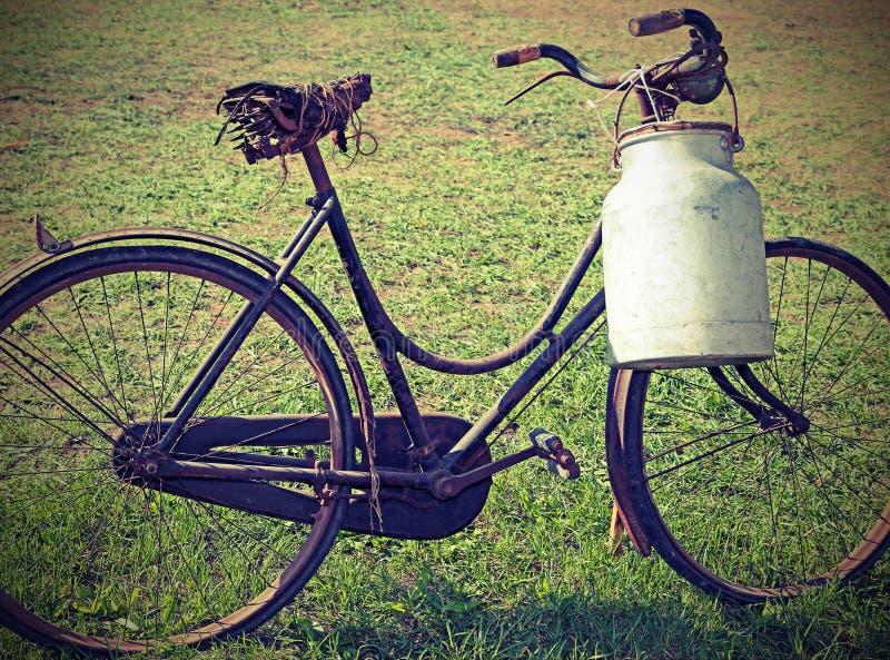 Ancient milking bike with milk bin stock photography