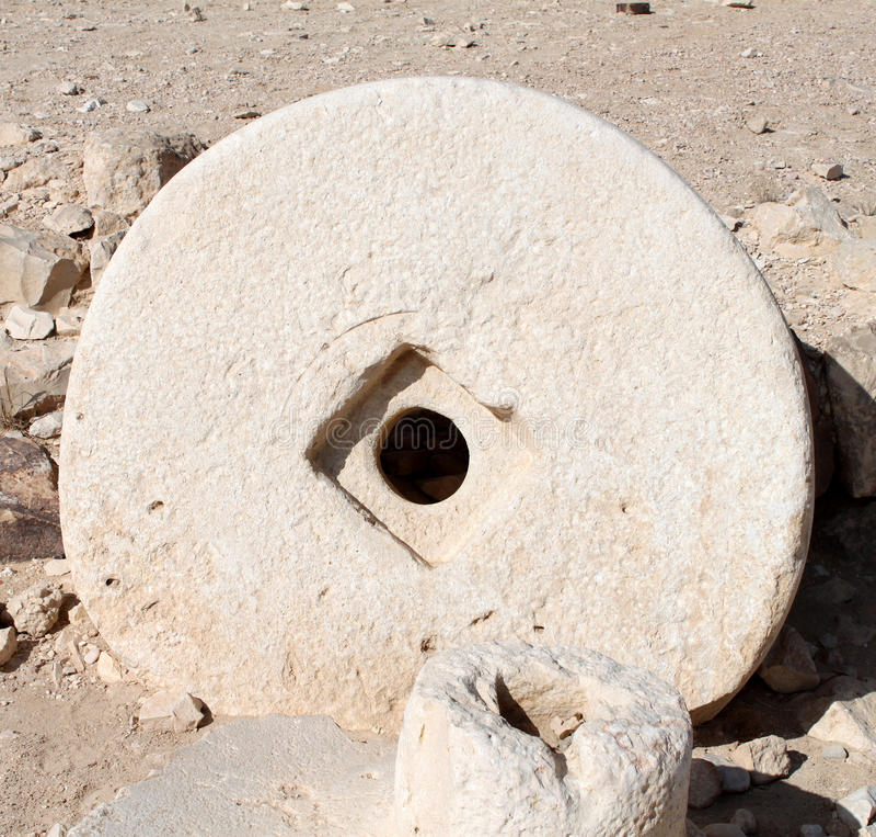 Ancient Millstone stock photo